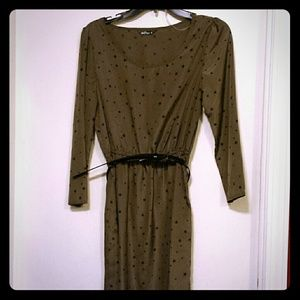 Olive colored belted blouse with black stars.